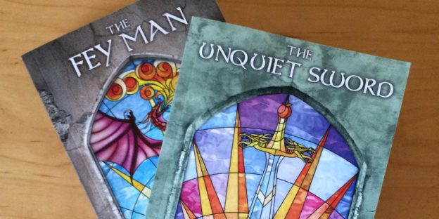 Paperback copies of The Fey Man and The Unquiet Sword
